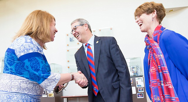 Dr. Doug Girod, executive vice chancellor of the KU Medical Center is congratulated by Lisa Pinamonti Kress, director of admission at KU with after being announced as the 18th chancellor of the University of Kansas on Thursday, May 25, 2017 at the Lied Center. At right is Girod's wife, Susan Girod.