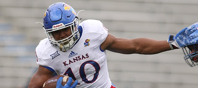 Team Jayhawk running back Khalil Herbert (10) escapes a defender during the first quarter of the 2017 Spring Game on Saturday, April 15 at Memorial Stadium.