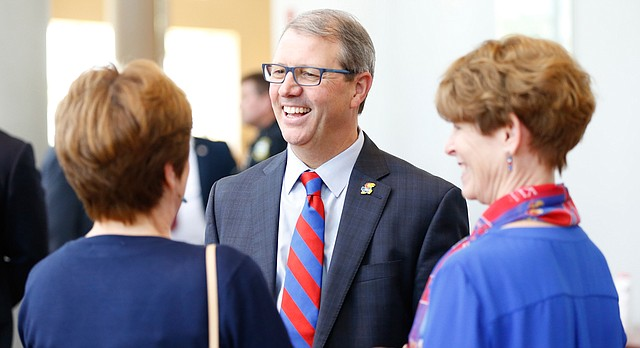 Dr. Douglas Girod, executive vice chancellor of the KU Medical Center, is congratulated by Jennifer Sanner, senior vice president for strategic communications and advocacy and editor of the Kansas Alumni magazine, after Girod was named as the 18th chancellor of the University of Kansas on Thursday, May 25, 2017 at the Lied Center. At right is Girod's wife, Susan Girod.