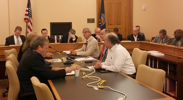 Members of a legislative tax committee meet Monday, June 5, 2017, at the Kansas Statehouse in Topeka.