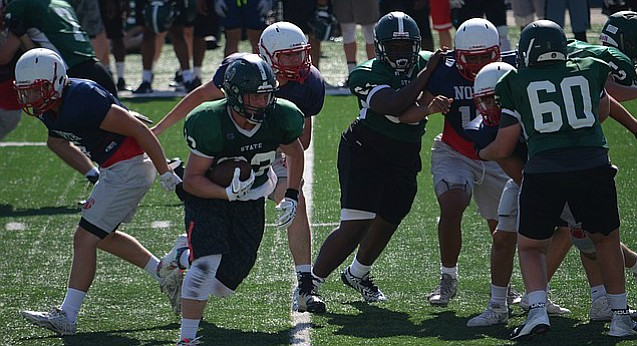 Free State running back Jax Dineen (33) carries the ball in a scrimmage against Olathe North during the University of Kansas football team camp at Memorial Stadium on June 5, 2017.