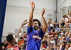 Blue Team guard Devonte' Graham  puts up a three over Red Team guard Ben McLemore during a scrimmage on Wednesday, June 7, 2017 at the Horejsi Family Athletics Center.