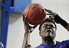 Blue Team center Udoka Azubuike is fouled by Red Team guard Tyshawn Taylor during a scrimmage on Wednesday, June 7, 2017 at the Horejsi Family Athletics Center.