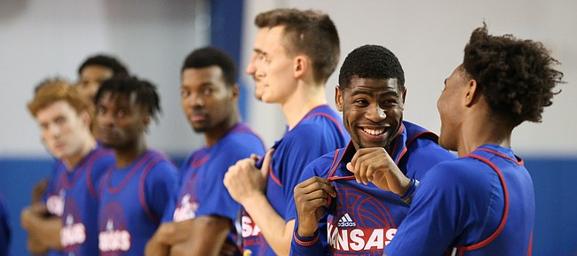 Blue Team guard Malik Newman laughs with teammate Devonte Graham before a scrimmage on Wednesday, June 7, 2017 at the Horejsi Family Athletics Center.