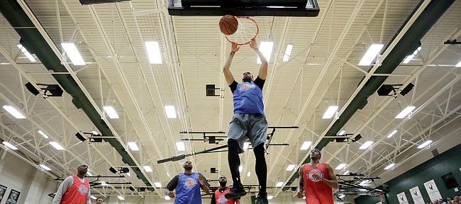 Perry Ellis drives the lane for a slam dunk during the 2017 Rock Chalk Roundball Classic Thursday evening at Lawrence Free State High School. The annual charity event benefits local families fighting cancer