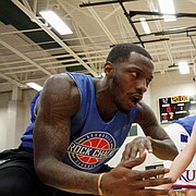 Tyshawn Taylor greets Dagen Korynta, 7, as Dagen runs through a lineup of former KU players during the 2017 Rock Chalk Roundball Classic at Free State High School. The annual charity event benefits local families fighting cancer. Dagen was diagnosed with cancer in 2015. As of January 2017, Dagen is in remission.