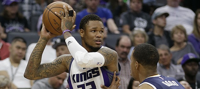 Sacramento Kings guard Ben McLemore, looks to pass against Utah Jazz guard Rodney Hood during the second half of an NBA basketball game Wednesday, March 29, 2017, in Sacramento, Calif. The Jazz won 112-82.