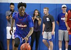 Blue Team guard Marcus Garrett brings the ball up the court during a scrimmage on Wednesday, June 7, 2017 at the Horejsi Family Athletics Center.