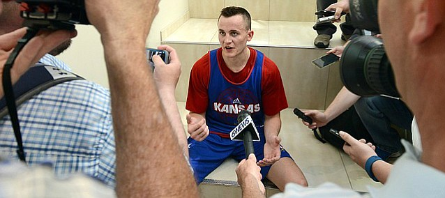 Kansas forward Mitch Lightfoot talks with the media following a camp scrimmage on Wednesday, June 14, 2017 at the Horejsi Family Athletics Center.
