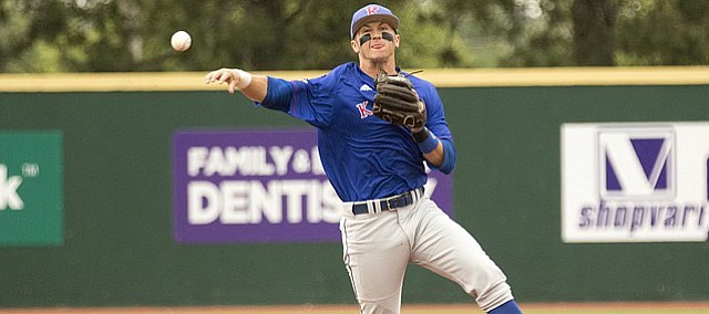 Kansas sophomore shortstop Matt McLaughlin makes a throw to first base for an out during the Jayhawks' game against Kansas State on Sunday afternoon at Tointon Family Stadium in Manhattan. The Jayhawks fell to the Wildcats, 8-5.