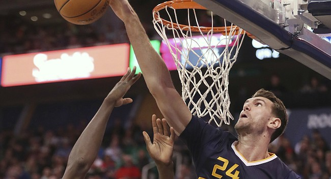 Utah Jazz center Jeff Withey, right, blocks the shot of Chicago Bulls forward Bobby Portis, left, during the first half at an NBA basketball game on Thursday, Nov. 17, 2016, in Salt Lake City. (AP Photo/George Frey)
