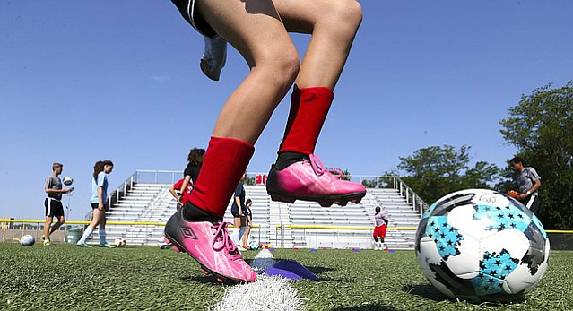 Free State players move through a line during a footwork drill at soccer camp on Monday, June 12, 2017.