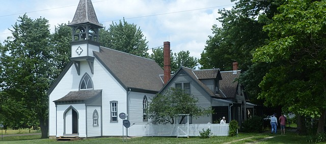 Visitors check out the Vinland Presbyterian Church at an open house Stephens Real Estate had Saturday for the 138-year-old church and its attached residence. The 17 shareholders who worked to save and restore the church after buying it in 2001 have put the property on the market.