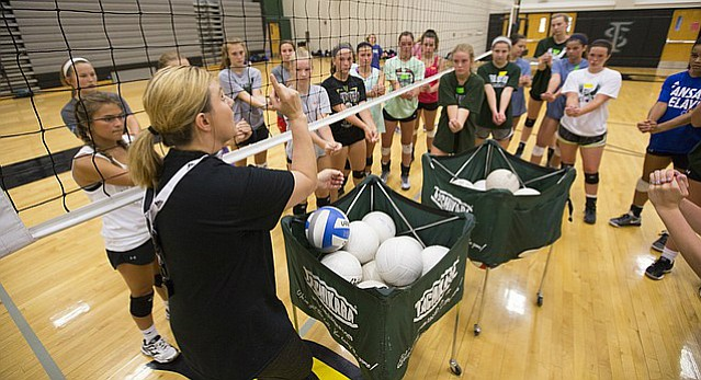 New Free State head volleyball coach Keely Hammontree gives some instruction during the first day of volleyball camp on Monday, June 12, 2017.