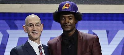 Kansas' Josh Jackson, right, poses for a photo with NBA Commissioner Adam Silver after being selected by the Phoenix Suns as the fourth pick overall during the NBA basketball draft, Thursday, June 22, 2017, in New York.
