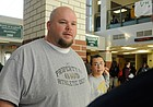 In this file photo from 2008, Keith Loneker Sr., a former University of Kansas football standout, works as a substitute teacher at Free State High School.