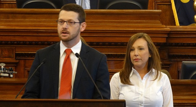 State Rep. John Wilson, D-Lawrence, stands with his wife, Jami Jones, on the House floor to announce his resignation from the 10th District House seat on June 26, 2017.