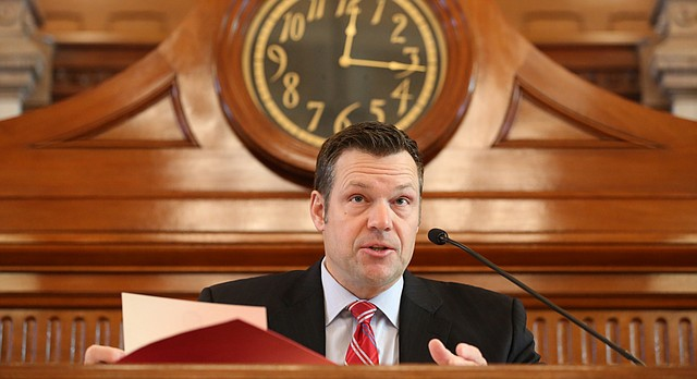 Kansas Secretary of State Kris Kobach presides over Kansas' Electoral College vote for the President of the United States in the Senate chambers of the Kansas Statehouse on Monday, Dec. 19, 2016 in Topeka, Kan.