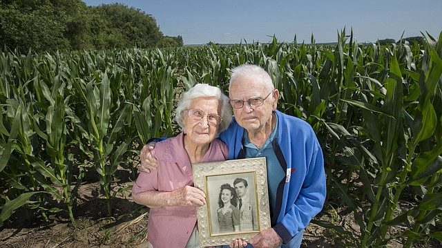 Lawrence residents Erwin and Wilma Morgan recently celebrated their 75th wedding anniversary. Erwin, 95, and Wilma, 93, are pictured with a photograph from their wedding day in 1942 in Lansing, Kan.