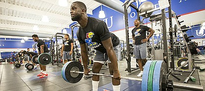 Kansas defensive end Josh Ehambe prepares for a lift during a workout at the Anderson Family Football Complex on Thursday, June 29, 2017.