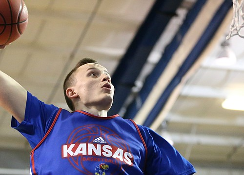 KU forward Mitch Lightfoot breaks nose, will be held out of contact for a few days