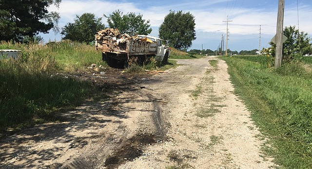 A charred spot along N. 1650 Road, just east of the Lawrence city limit, is pictured Monday, July 3, 2017. On Sunday night, a Douglas County sheriff's deputy discovered a body inside a burning vehicle that apparently had left the roadway. The incident remained under investigation Monday.