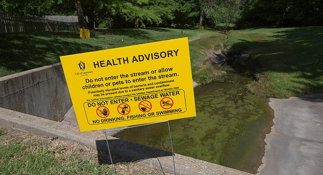 Various health advisory signs, pictured July 3, 2017, were posted around a creek just west of Monterey Way between Sixth and Eighth Street where unauthorized dumping of used cooking grease was discovered.