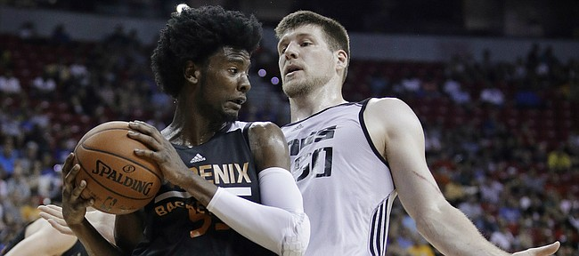 Phoenix Suns' Josh Jackson grabs a rebound next to Sacramento Kings' Jack Cooley during the first half of an NBA summer league basketball game, Friday, July 7, 2017, in Las Vegas.