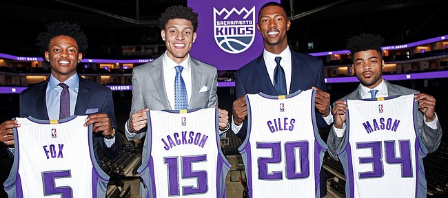 Sacramento rookies, from left to right, De'Aaron Fox, Justin Jackson, Harry Giles and Frank Mason, pose with Kings jerseys representing the spot each player was picked in this year's NBA Draft. On Friday, July 7, 2017, the foursome officially got their NBA careers under way with their summer league debuts in Las Vegas.