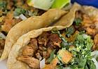 Tacos pastor with onions, cilantro and adobo sauce at La Estrella, 2449 Iowa St., Suite D.