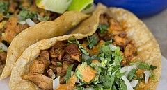 Tacos pastor with onions, cilantro and adobo sauce at La Estrella, 2449 Iowa St.,