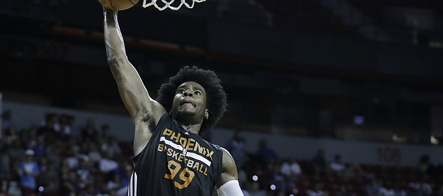 Phoenix Suns' Josh Jackson shoots over Dallas Mavericks' Carrick Felix during the second half of an NBA summer league basketball game, Sunday, July 9, 2017, in Las Vegas.