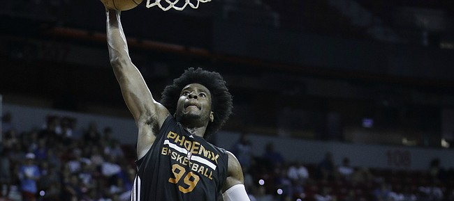 Phoenix Suns' Josh Jackson shoots over Dallas Mavericks' Carrick Felix during the second half of an NBA summer league basketball game, Sunday, July 9, 2017, in Las Vegas.