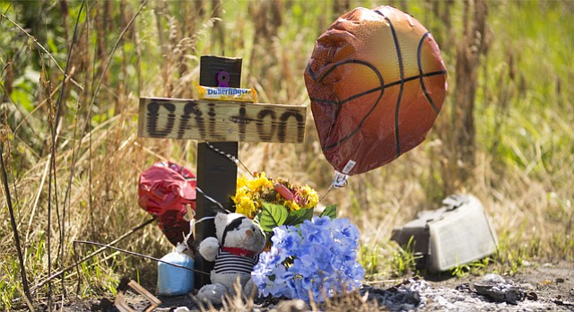 A memorial for Dalton Hess sits at the site of the road in the 1600 block of North 1650 Road just northeast of Lawrence.