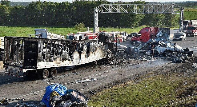 Investigators survey the scene of a multi-vehicle accident that killed multiple people on Tuesday, July 11, 2017, on westbound Interstate 70 just west of Bonner Springs. (Keith Myers/The Kansas City Star via AP)