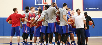 The Jayhawks come together in a huddle to start practice on Tuesday, July 11, 2017. The Jayhawks are preparing for four early-August exhibition games in Italy.