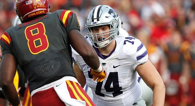 Kansas State offensive lineman Scott Frantz, right, looks to block Iowa State defensive end Jhaustin Thomas (8) during the second half of an NCAA college football game, Saturday, Oct. 29, 2016, in Ames, Iowa. (AP Photo/Charlie Neibergall)