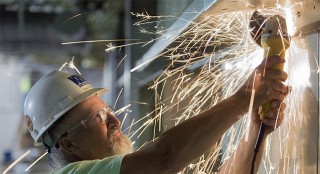 Sparks fly as Tom Corwin with KBS Construction works to remove a section of an I-beam to make way for a garage door in the automotive center currently being constructed at Peaslee Tech, 2920 Haskell Ave #100, on Thursday, July 13, 2017. The technical training center is seeking additional funding from the city and county. As recommended budgets currently stand, only a portion of the tech center's request is likely to be fulfilled.