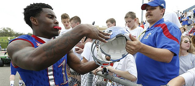 Kansas safety Mike Lee signs autographs following the 2017 Spring Game on Saturday, April 15 at Memorial Stadium.