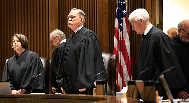 Chief Justice Lawton Nuss, third from left, lead justices to their seats to hear arguments on a school funding case before the Kansas Supreme Court in Topeka, Kan., Tuesday, July 18, 2017. (AP Photo/Orlin Wagner)
