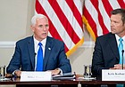 Vice President Mike Pence, left, accompanied by Vice-Chair Kansas Secretary of State Kris Kobach, right, speaks during the first meeting of the Presidential Advisory Commission on Election Integrity at the Eisenhower Executive Office Building on the White House complex in Washington, Wednesday, July 19, 2017. (AP Photo/Andrew Harnik)