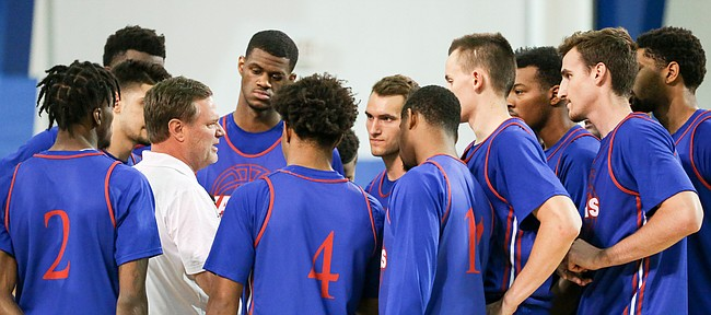 Kansas head coach talks with his players before a scrimmage on Wednesday, June 7, 2017 at the Horejsi Family Athletics Center.