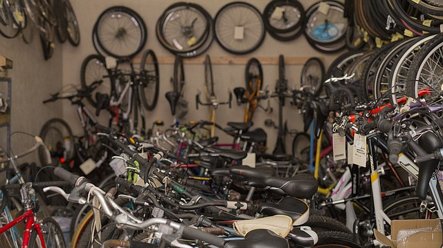 About 60 bicycles are crammed into a 12-by-24-foot studio space at Art Emergency. During workshop nights, Lawrence Unchained organizers pull many of the bikes out into a common space for volunteers to work on and repair.