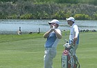Chris Thompson and caddie Brad Ziegler watch Thompson's second shot on-par 5 No. 7 at Indian Creek in Omaha in Sunday's final round of the Pinnacle Bank Championship, a web.com tour event. He finished tied for 23rd.