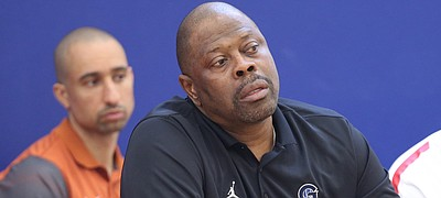 Georgetown head coach Patrick Ewing, front watches during the Hardwood Classic on Friday, July 21, 2017 at Sports Pavilion Lawrence. In back is Texas head coach Shaka Smart.