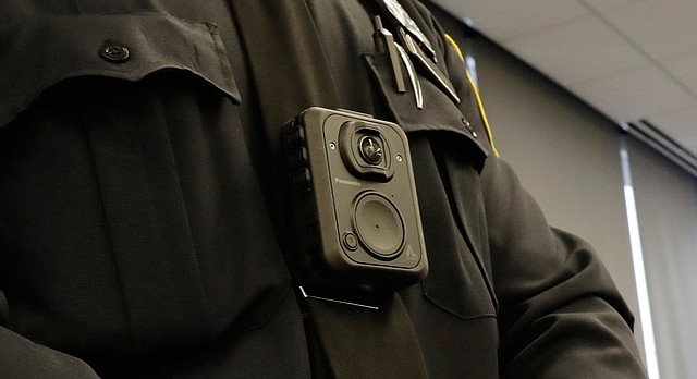 A Newark police officer wears a body camera during a news conference unveiling the cameras, Wednesday, April 26, 2017, in Newark, N.J. (AP Photo/Julio Cortez)
