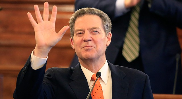 Gov. Sam Brownback waves to guests before delivering his state of the state address to a joint session of the Kansas legislature in Topeka, Kan., Tuesday, Jan. 10, 2017. (AP Photo/Orlin Wagner)