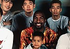 Young Landen Lucas sits with his father, Richard Lucas, for an impromptu team photo during Richard's playing days in Japan. Lucas recently agreed to a professional contract with a Japanese team based in Tokyo.