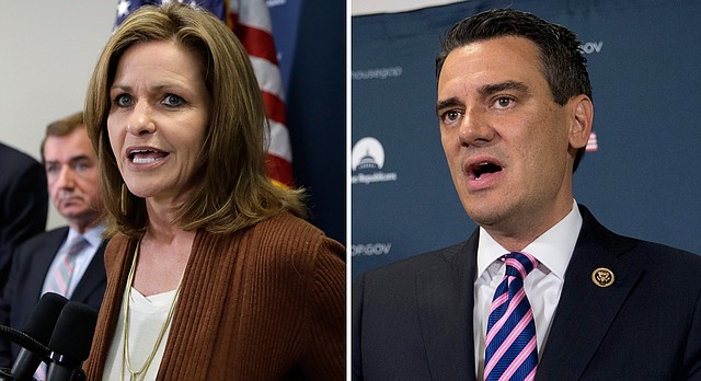 Kansas Reps. Lynn Jenkins, left, and Kevin Yoder, right.