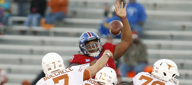 Kansas defensive tackle DeeIsaac Davis (99) gets up to bat down a pass by Texas quarterback Shane Buechele (7) during the third quarter on Saturday, Nov. 19, 2016 at Memorial Stadium.